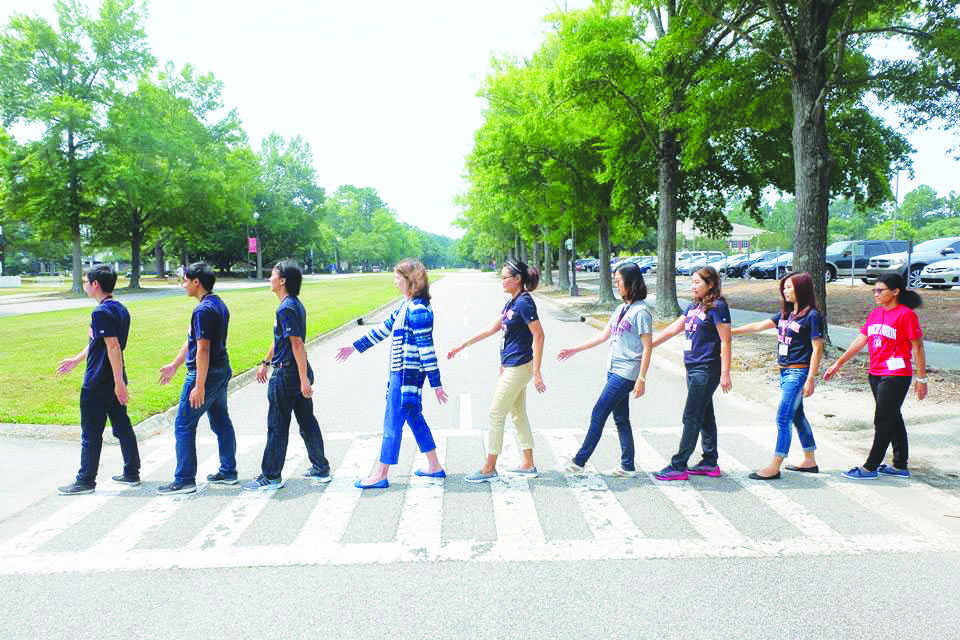 """Haselden said that the Thai teachers mentioned several times wanting to recreate the photo """"Abbey Road"""" originally portrayed by the Beatles in 1969. Haselden is the fourth person from the left."""