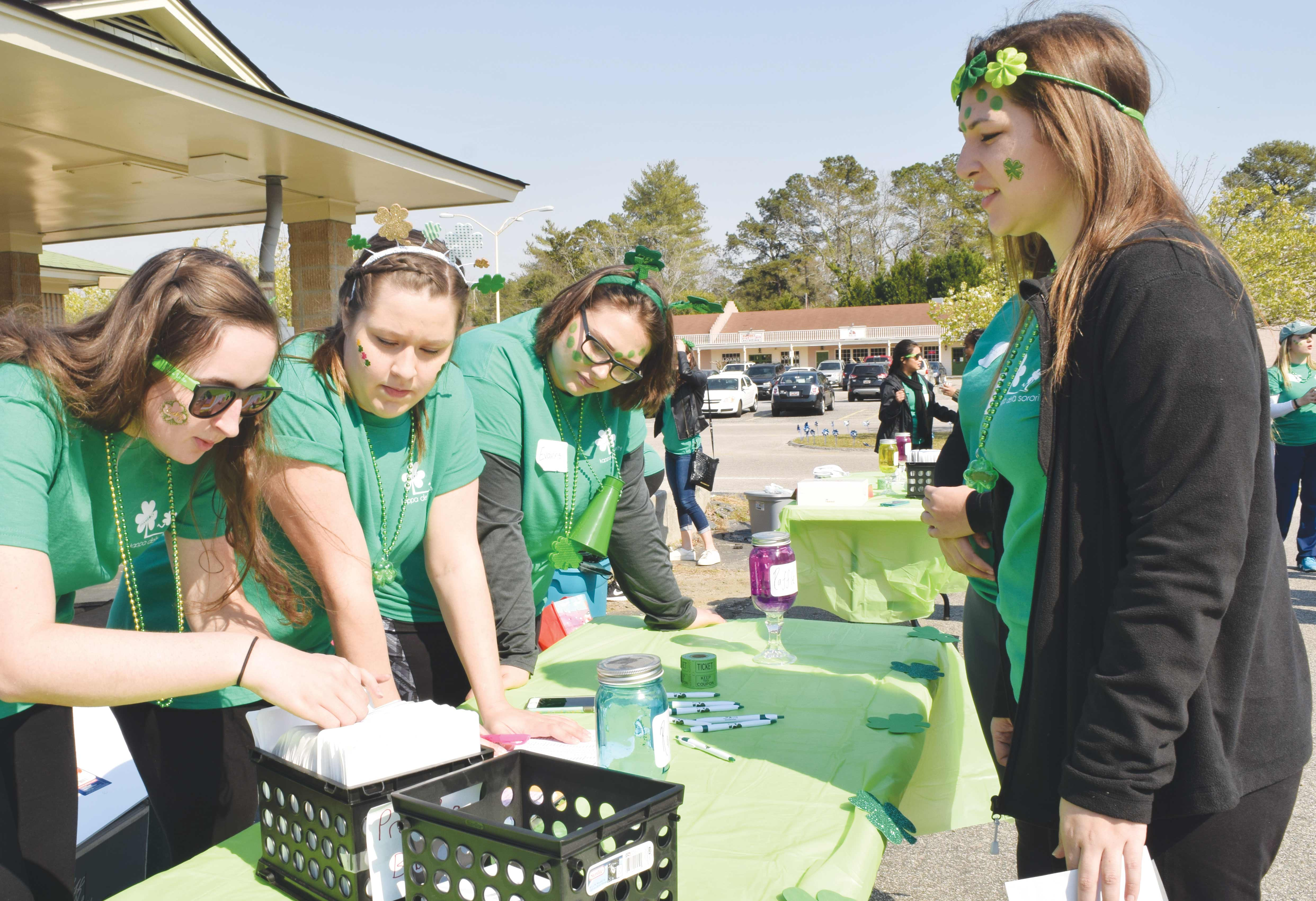 KD members work at the registration booth during the March 4 5K. Proceeds were donated to the Durant Children's Center and National Prevent Child Abuse America.