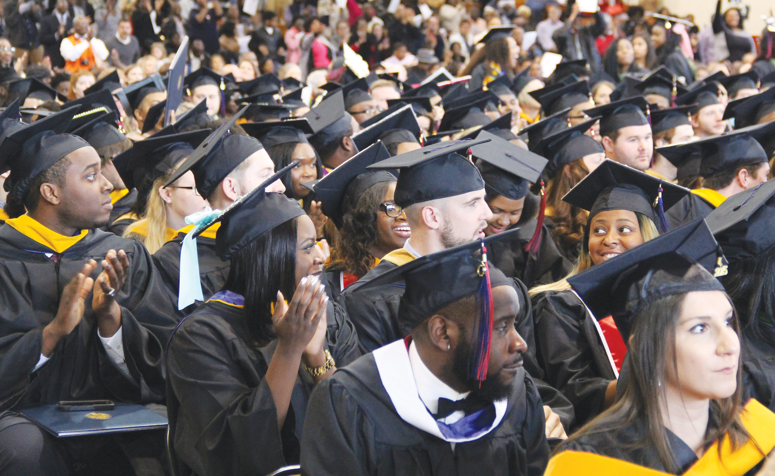 Students celebrate their achievements as they prepare to become alumni during FMU's fall commencement ceremony in December 2016.