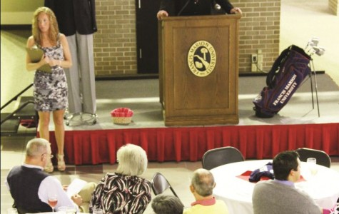 Auction held for athletics program