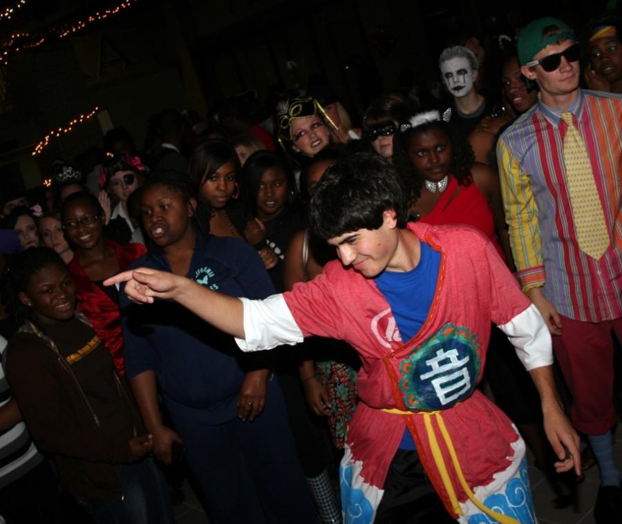 Sophomore Ian Wallance challenges others in attendance to a dance-off. A crowd quickly gathered around him to witness his moves at Carn-Evil on Oct. 28.