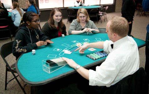 Students play cards at Casino Royale