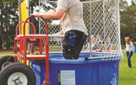 Alive in Christ dunks professors for charity