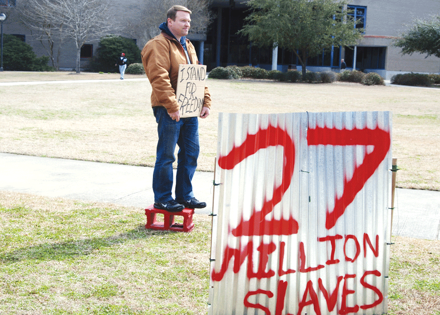 Baptist Collegiate Ministries stands to raise awareness about human slave trafficking