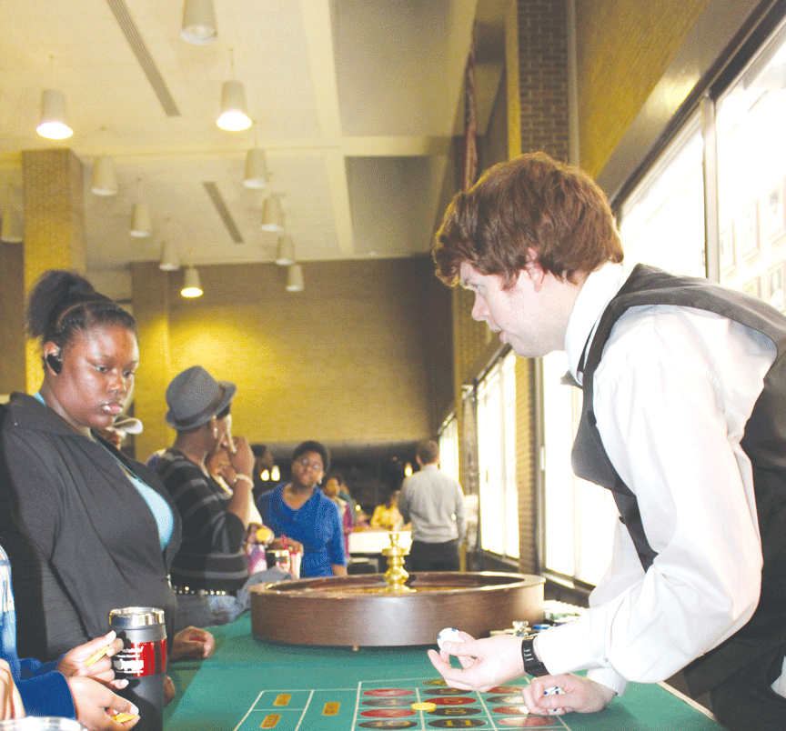 Students fold 'em and hold 'em Patriots push their luck at Homecoming event