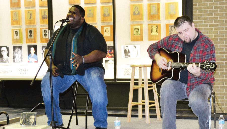 Artist Chinua Hawk performs live at UPB coffee shop night