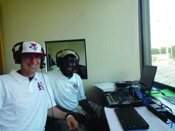 FMU student Tim Laurent (left) and graduate Armand Broady (right) preparing to announce for the Florence RedWolves. The RedWolves is a semi-professional baseball team in Florence.