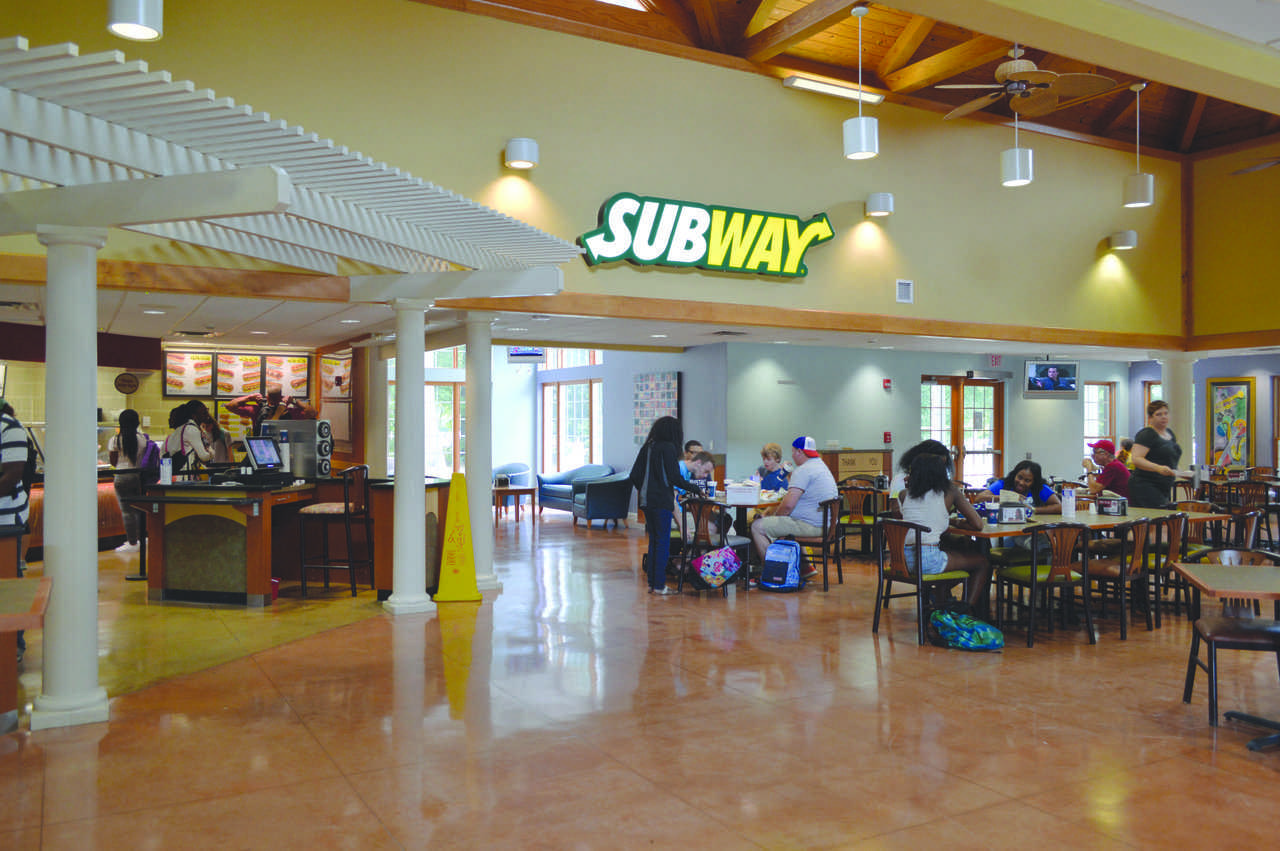 Students and faculty eat lunch at The Grille, trying out the Subway addition on its opening day.