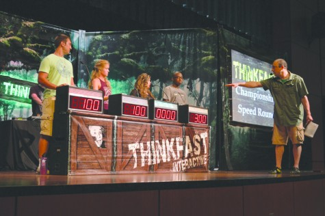 Students participate in the Think Fast Game Show. Jimmy Carter, Be a Wach, McKayla Parker and Kalil Johnson compete to answer questions and earn points for their teams.