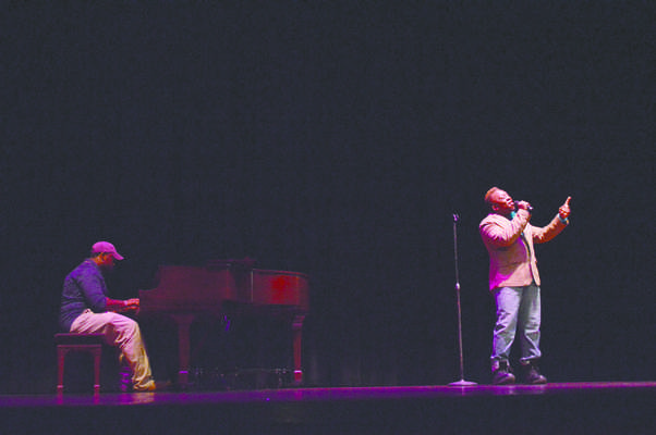"""Alex Smoot and CurkRoy Brown sang Janine and the Mixtape's """"Hold Me"""" during the Coalition's Talent Show."""