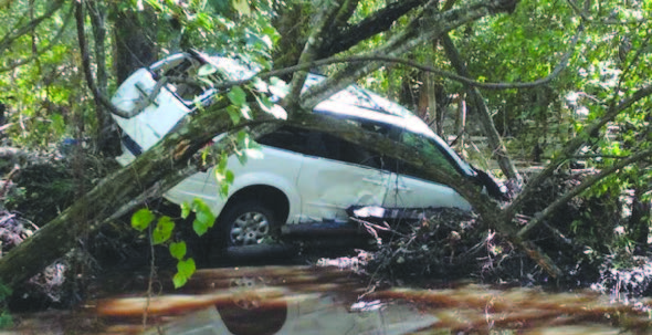 A Florence County resident crashes in the washout on Old River Road near FMU. Other road washouts prevent students' commute to school.