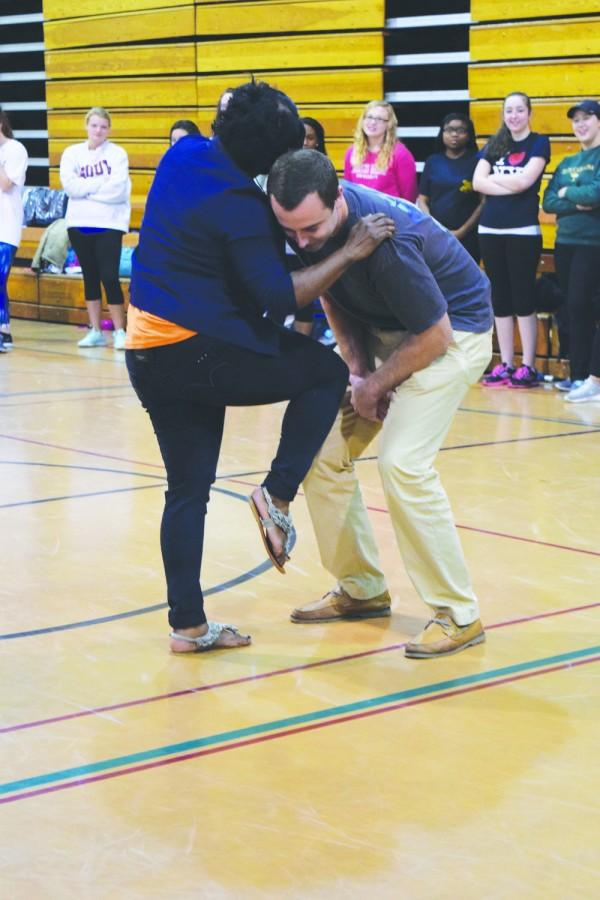 Tracy Williamson demonstrates self defense techniques with the help of student Hayden Bunch during Fight Back.