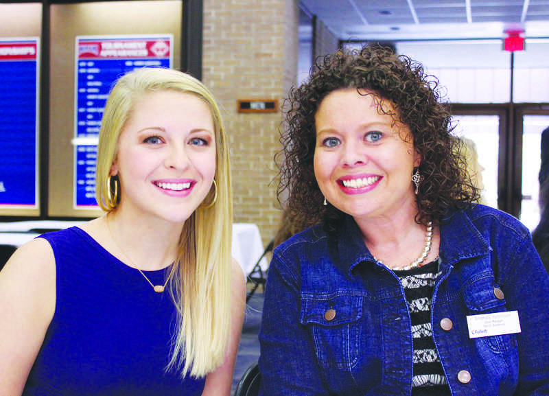 Junior nursing student Grayson Hucks receives a donor-based scholarship from the Follett Corporation, the corporation that manages the Patriot Bookstore.