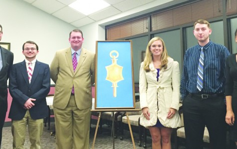 Pi Sigma Alpha, the National Political Science Honor Society, inducts seven new members into its ranks, including honorary initiate Florence Mayor Stephen Wukela. This ceremony was on of many inductions.