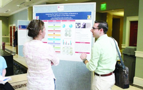 Senior Lucas Murley presents his research on the types of bacteria found on ice and toilets at FMU. Murley and Whitney Weber are conducting this research for their honor's thesis.