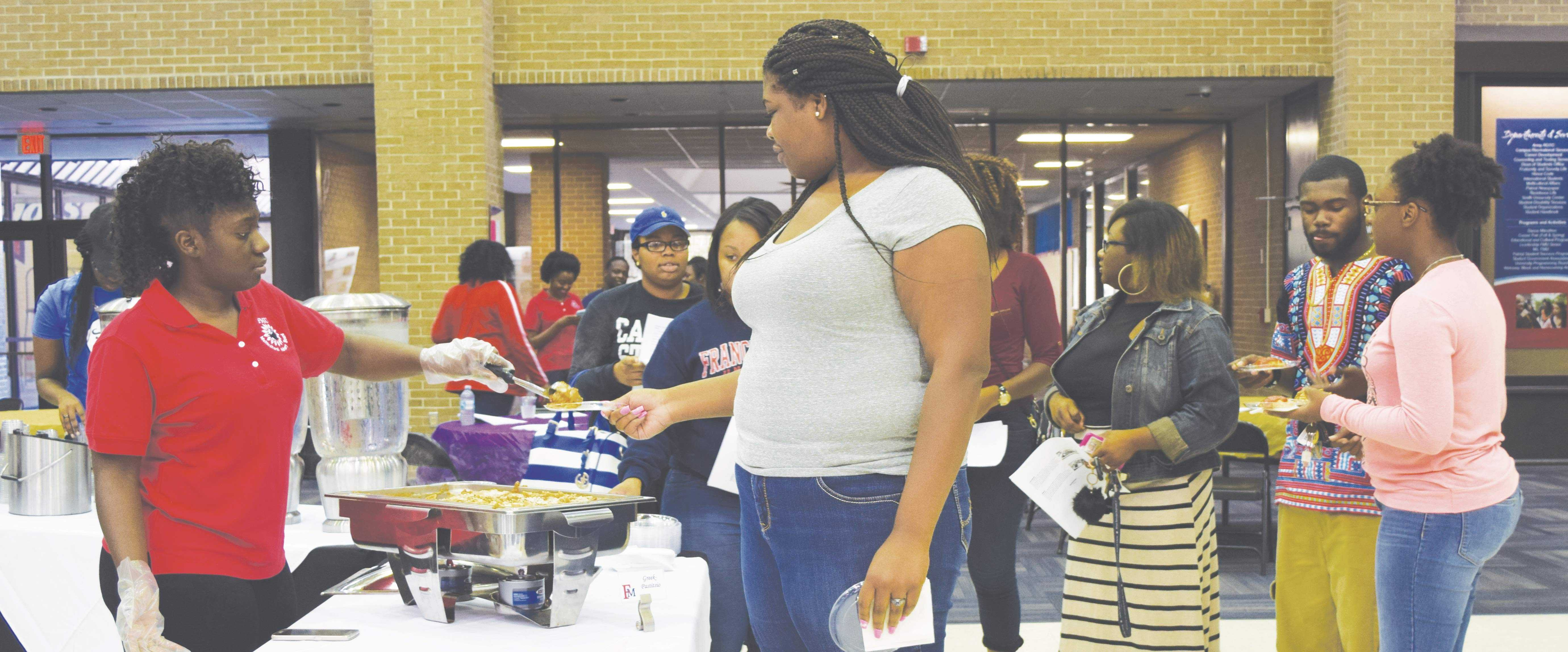 Students try international dishes at the Cultural Food Fest. The dishes' recipes, which came from countries such as Greece, Brazil and Jamaica, were made available at the event.