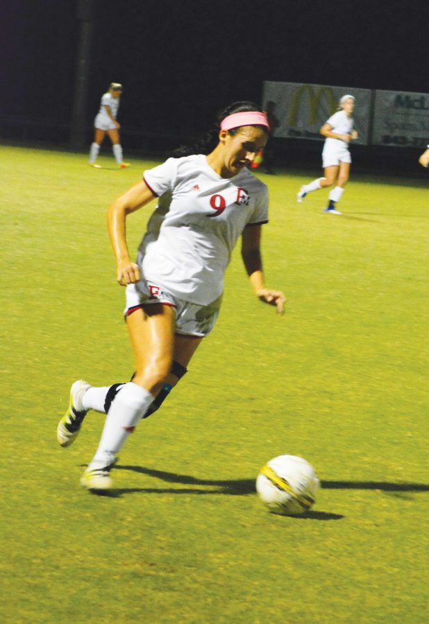 Defensive player Mia Much (9) runs the ball down the field during the Oct. 19 game against the Georgia College Bobcats.