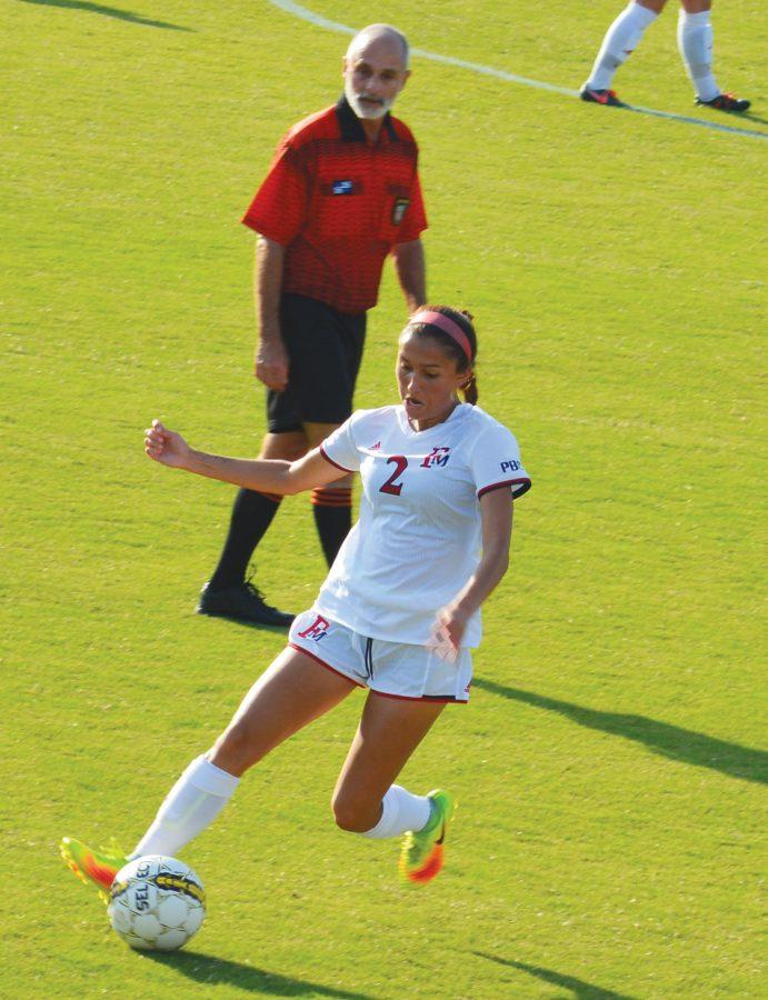 Freshman Avery Towns (2) assists senior Tori Whigham (20) in scoring the only goal made by the lady Patriots against Lander.