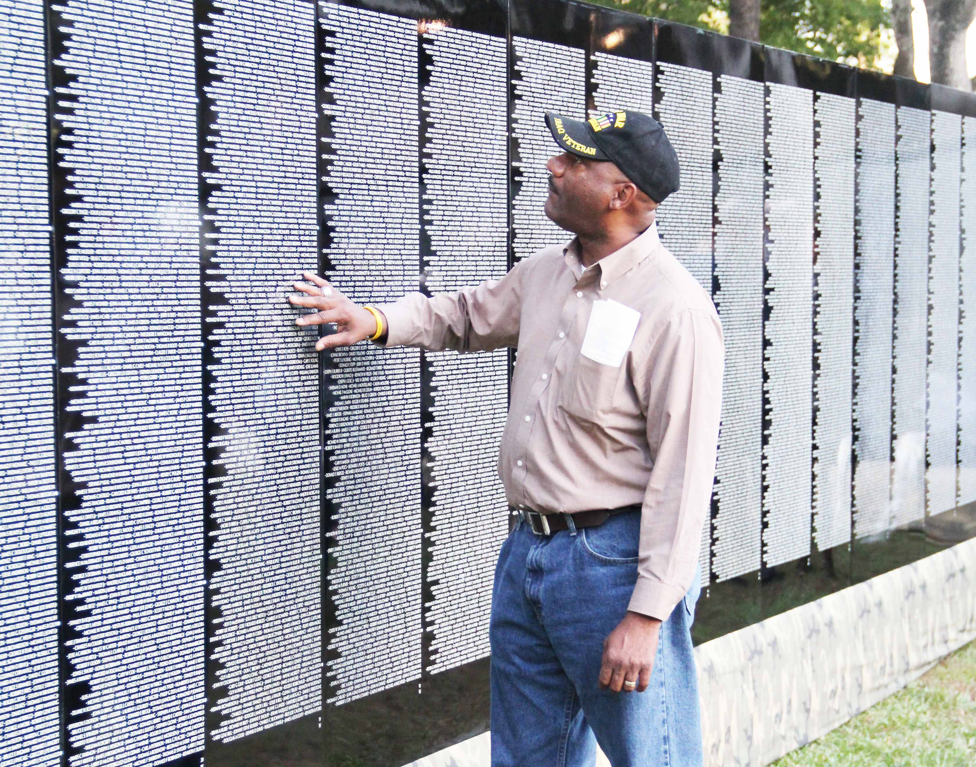 Veterans of the Vietnam War visit the wall throughout the week, searching for names of fallen comrades and loved ones.