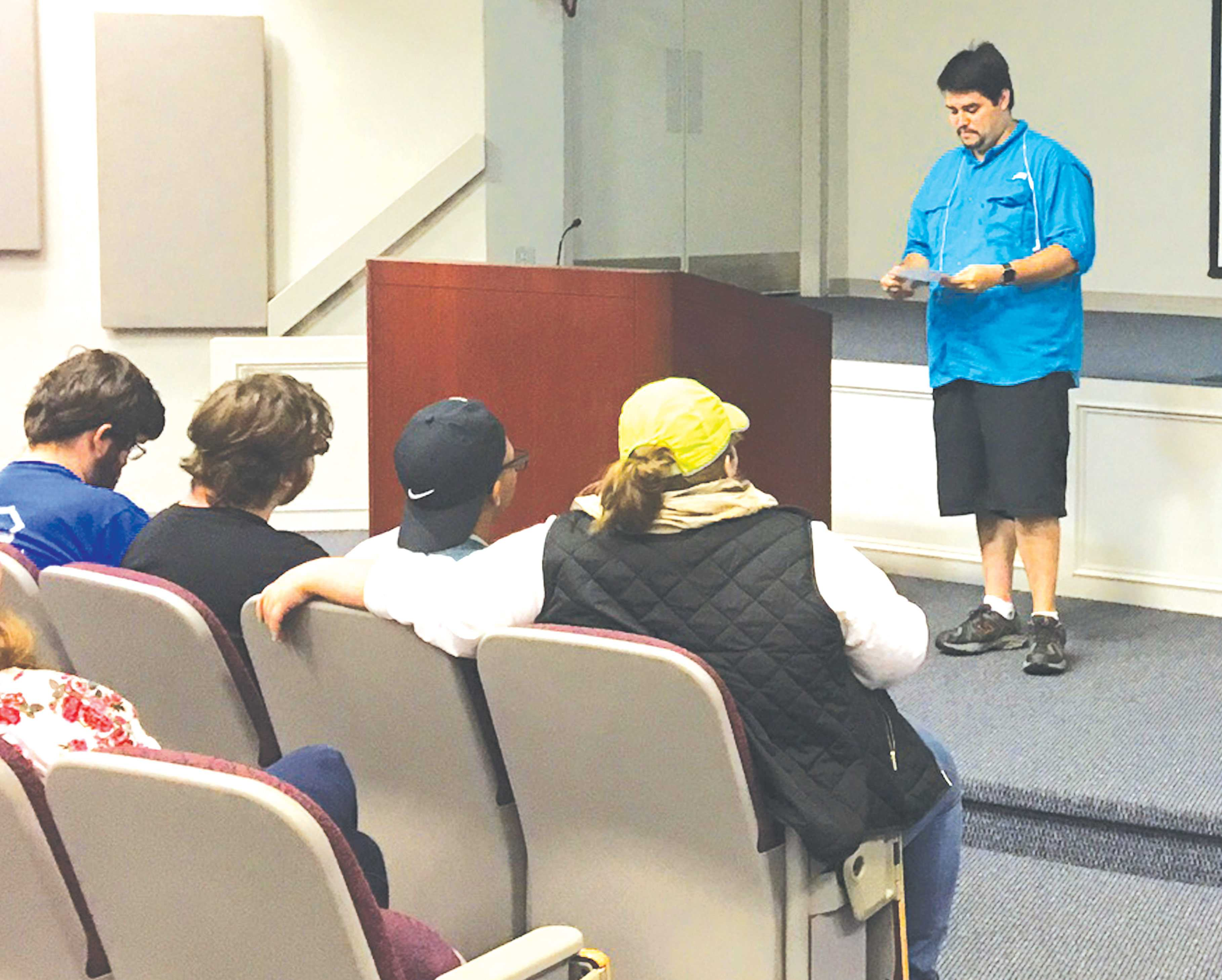 Mitchell Aldaco reads his original poetry at the poetry slam. Aldaco won second place in the competition and received a $5 gift certificate to Barnes and Noble.