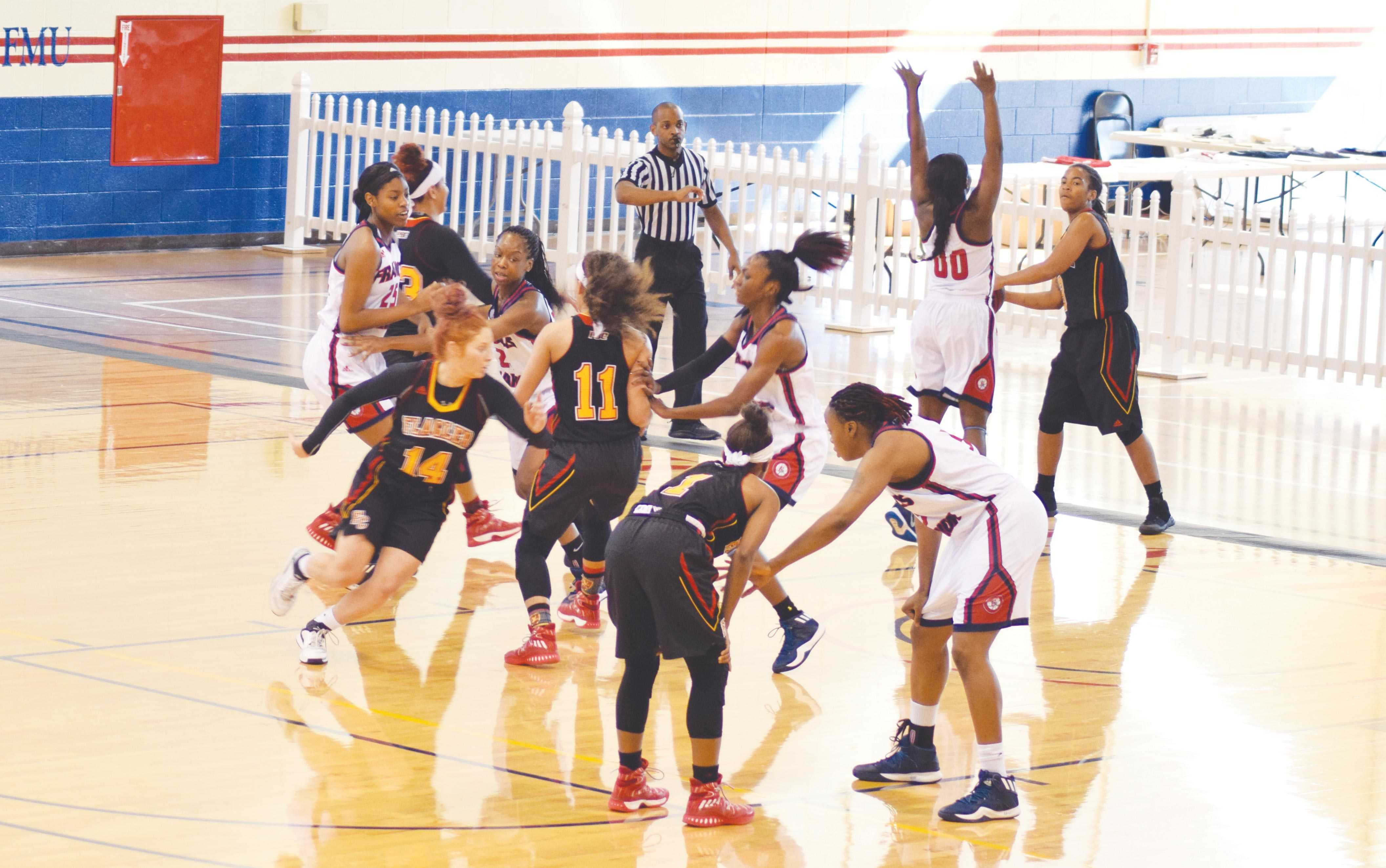 The women's basketball team attempts to prevent Flagler from maintaining possession of the ball.