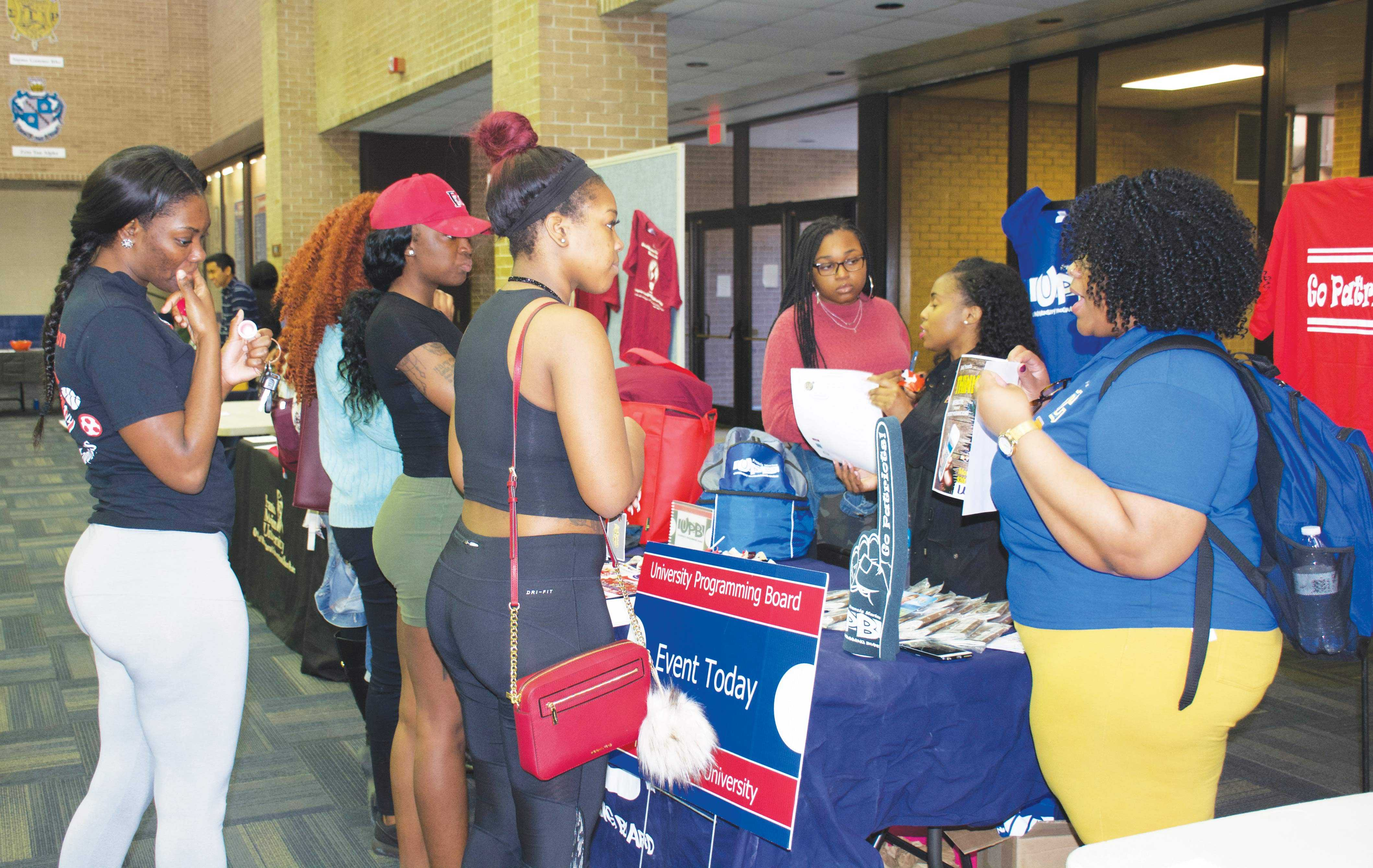 Students talk to members of an organization at the spring involvement fair to learn about groups they are interested in joining.