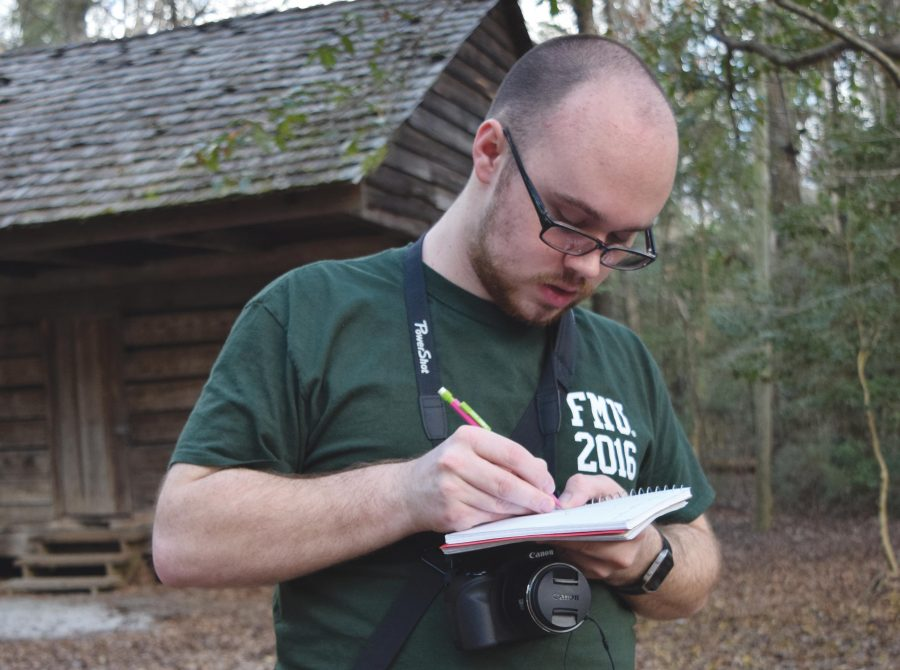 Senior+Kyle+Stewart+is+compiling+a+catalogue+of+plant+species+located+on+the+FMU+nature+trail+for+his+honors+thesis+so+that+nature+trail+visitors+can+more+easily+identify+the+variety+of+plants.