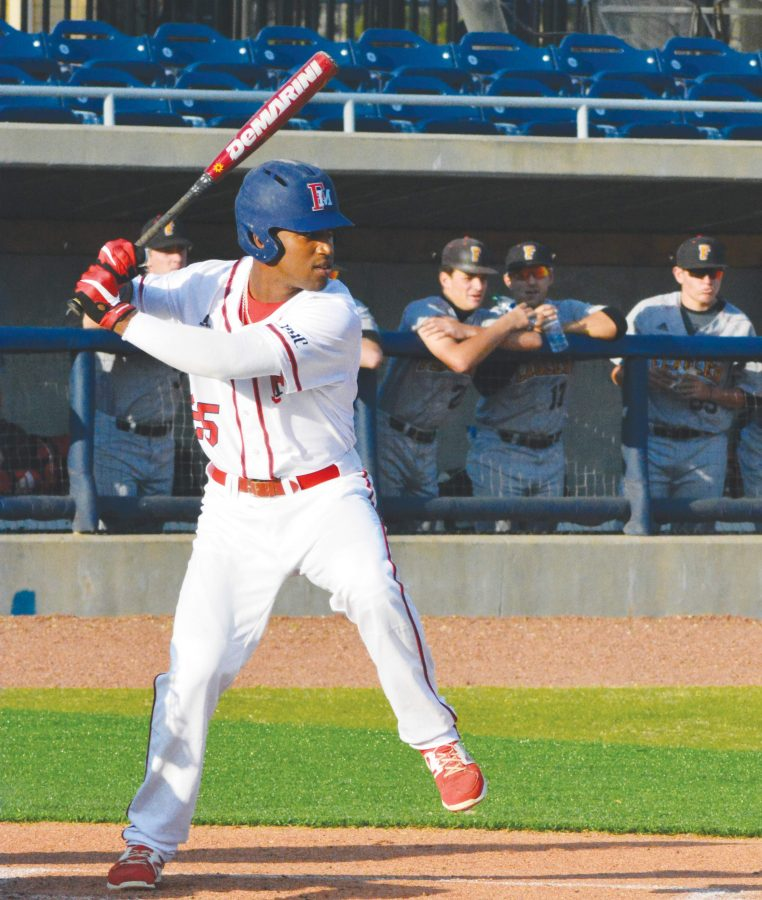 Reese+Cooley+%2825%29+takes+his+turn+at+bat+during+FMU%E2%80%99s+double+header+against+Flagler+College.