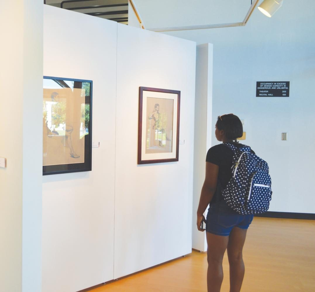 Students look at the art by Vilas Tonape and Kate Furman that is on display in the Hyman Fine Arts Center. The gallery focuses on the use of human form and natural elements.