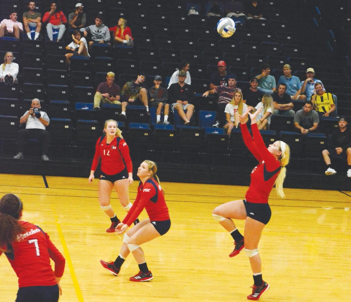 Senior Shelbi Meek prepares to set the ball during the Sept. 8 match against Chowan University during the FMU Invitational Volleyball Tournament.