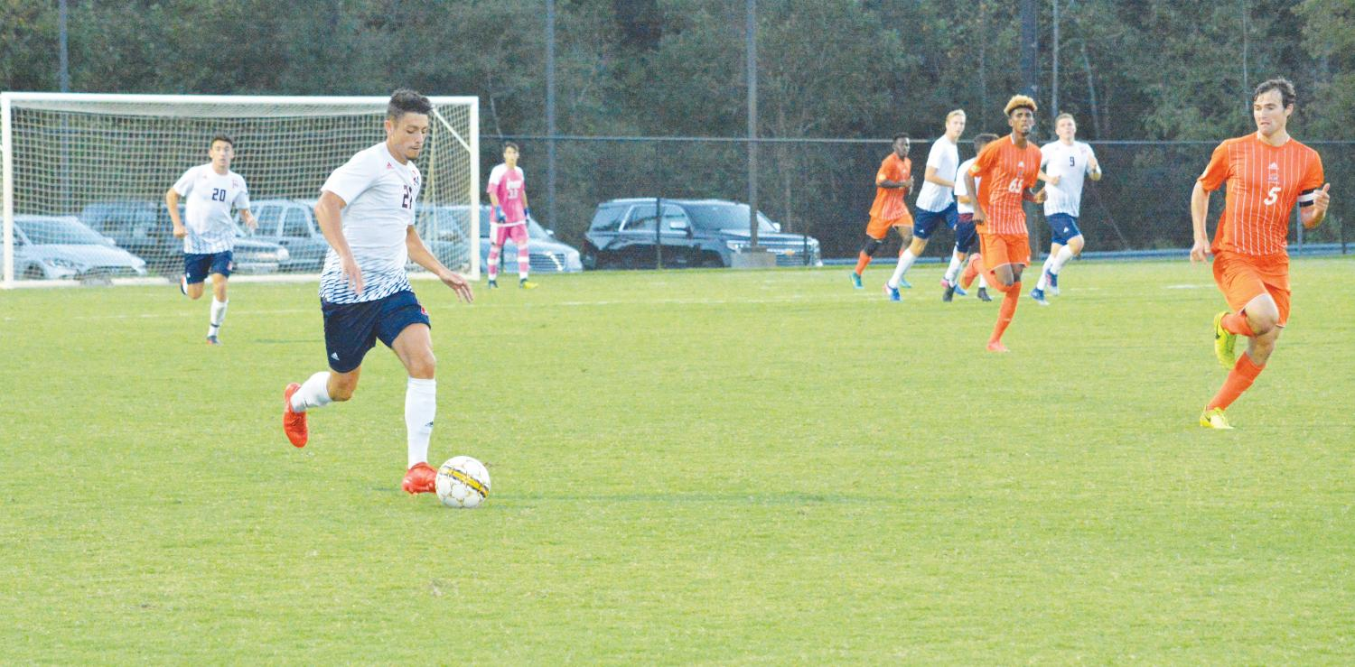 Sophomore Damien Tergella drives the ball down the field during the Sept. 30 match against the Clayton State Lakers. This match marks the first home PBC game of the season.