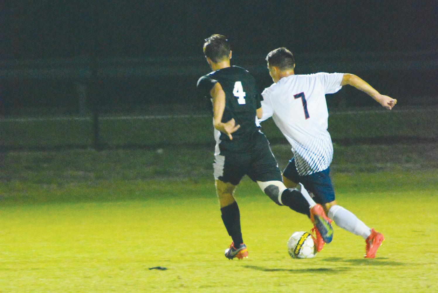 Gaspard Mianne pushes past a Lenior-Rhyme University defender. The Oct. 14 game brings the patriots to a 6-6-0 record.