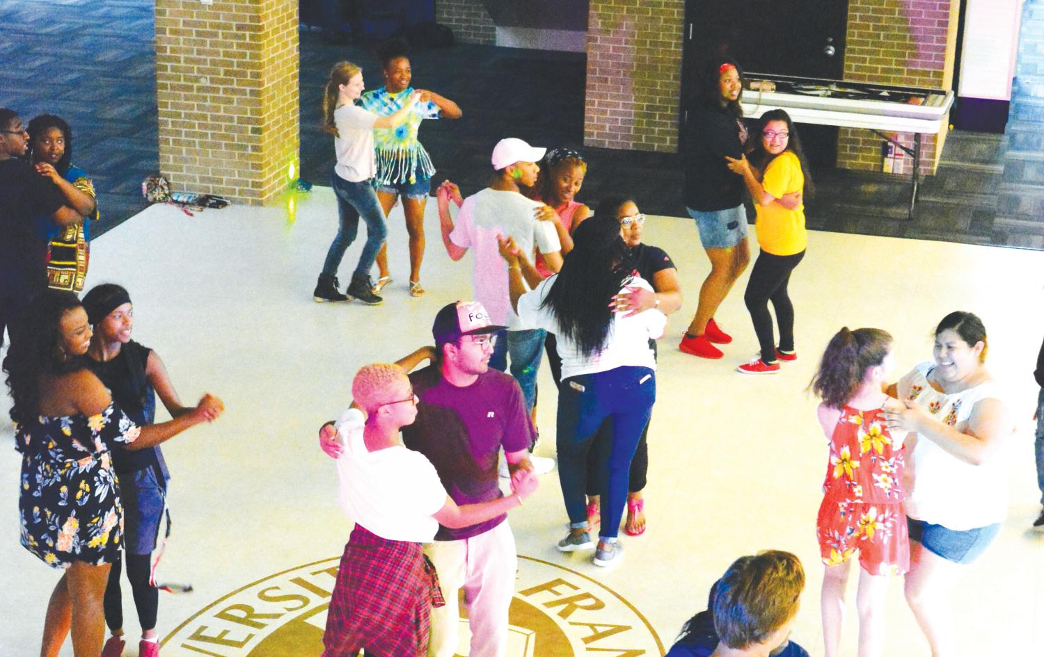 Students learn to salsa dance during the Salsa Magic event to celebrate Hispanic Heritage Month.