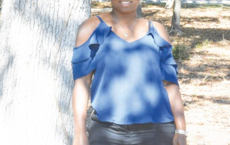 FMU pre-nursing major Marie Virgile is a single parent and immigrant from Haiti.