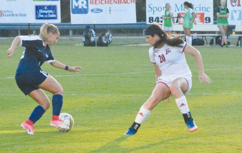 Freshman forward Kylie McElroy jockeys to win ball from Columbus State midfielder.