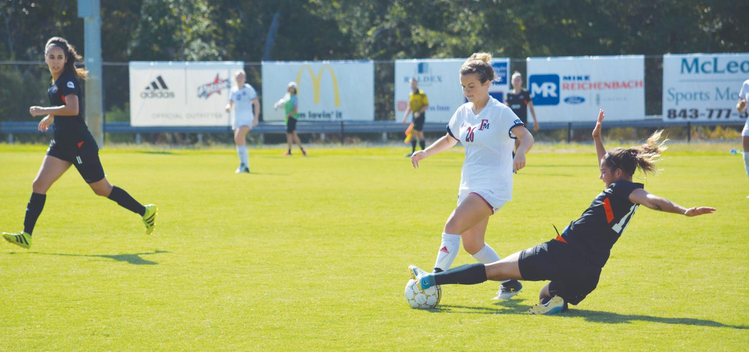 Holly Bowman, freshman mid-fielder, maneuvers around the Lakers' defense. The match against Clayton State brings the Patriots to a 3-4-0 record.