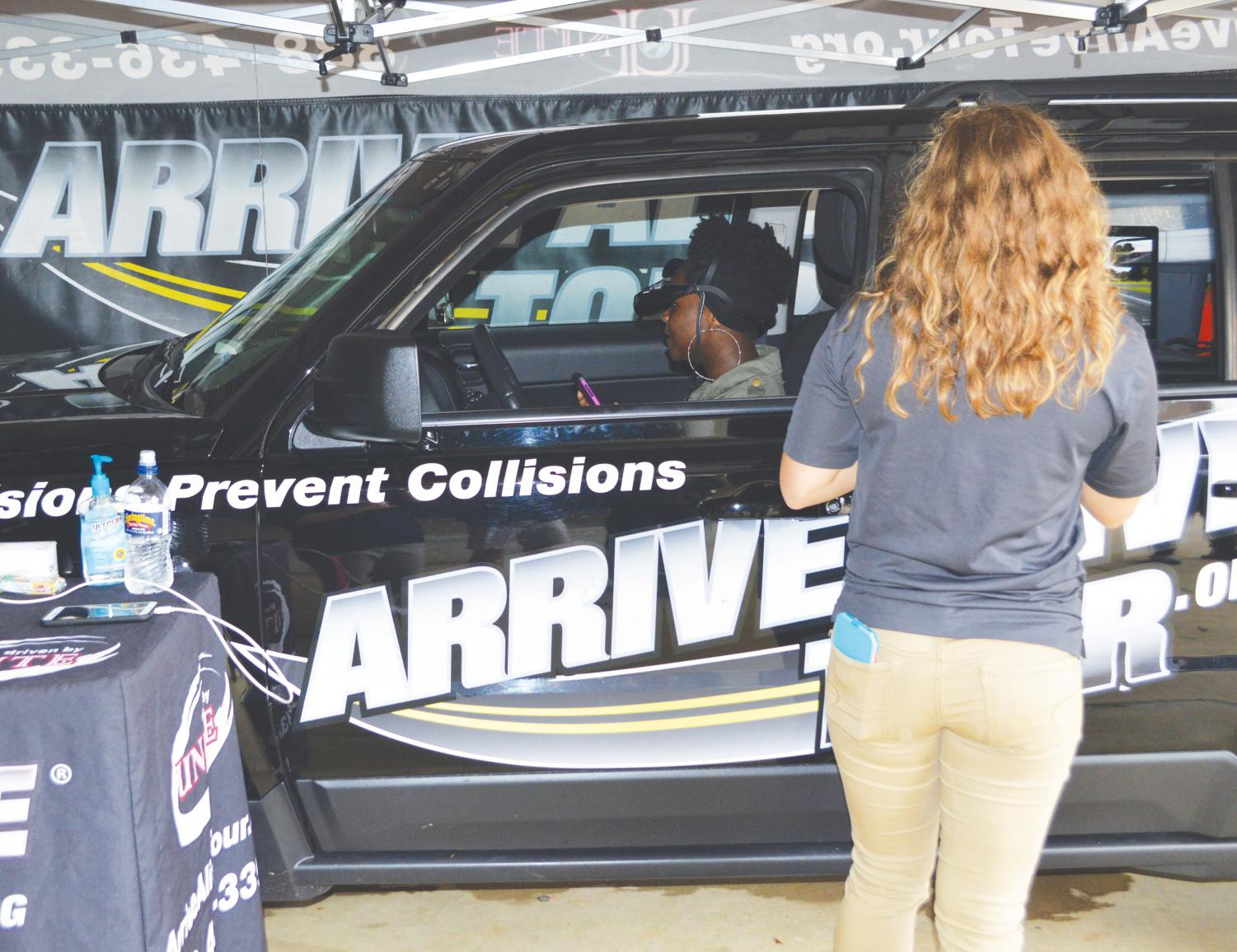 An FMU student participates in the distracted driving simulation during the Oct. 23 event.