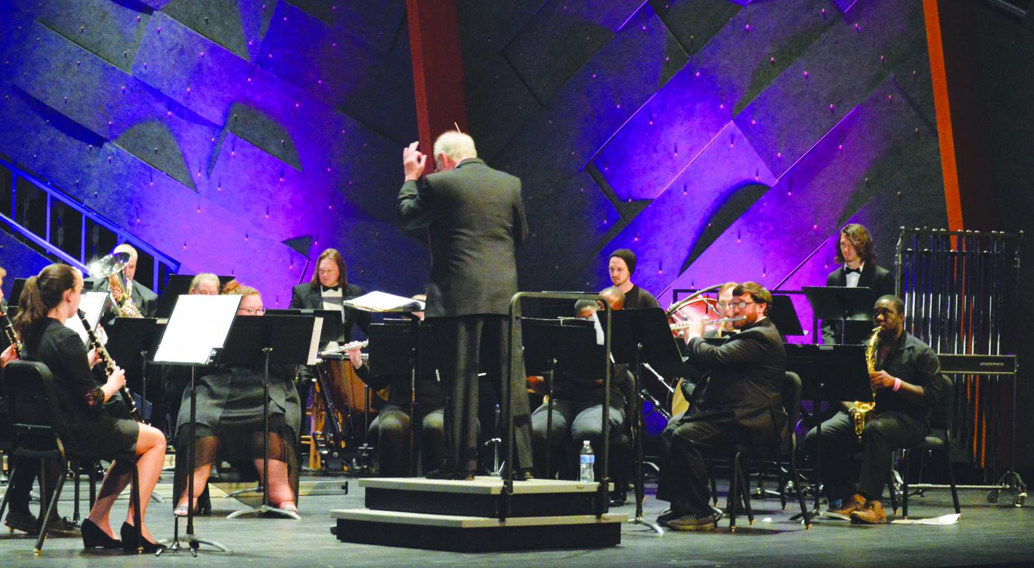 The FMU Concert Band performs a Halloween-themed concert with pieces from