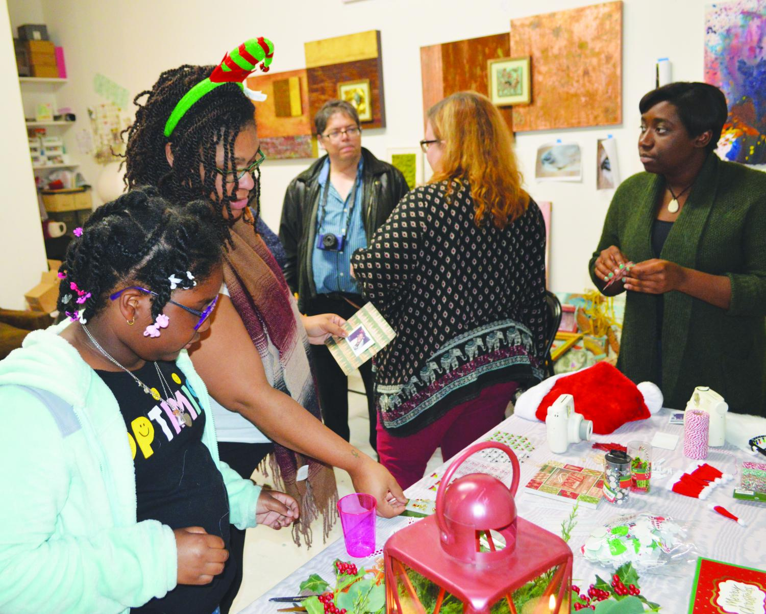 FMU Students take part in creating ornaments from Polaroids at TthomasArts, a local art studio, during the Nov. 9 workshops.