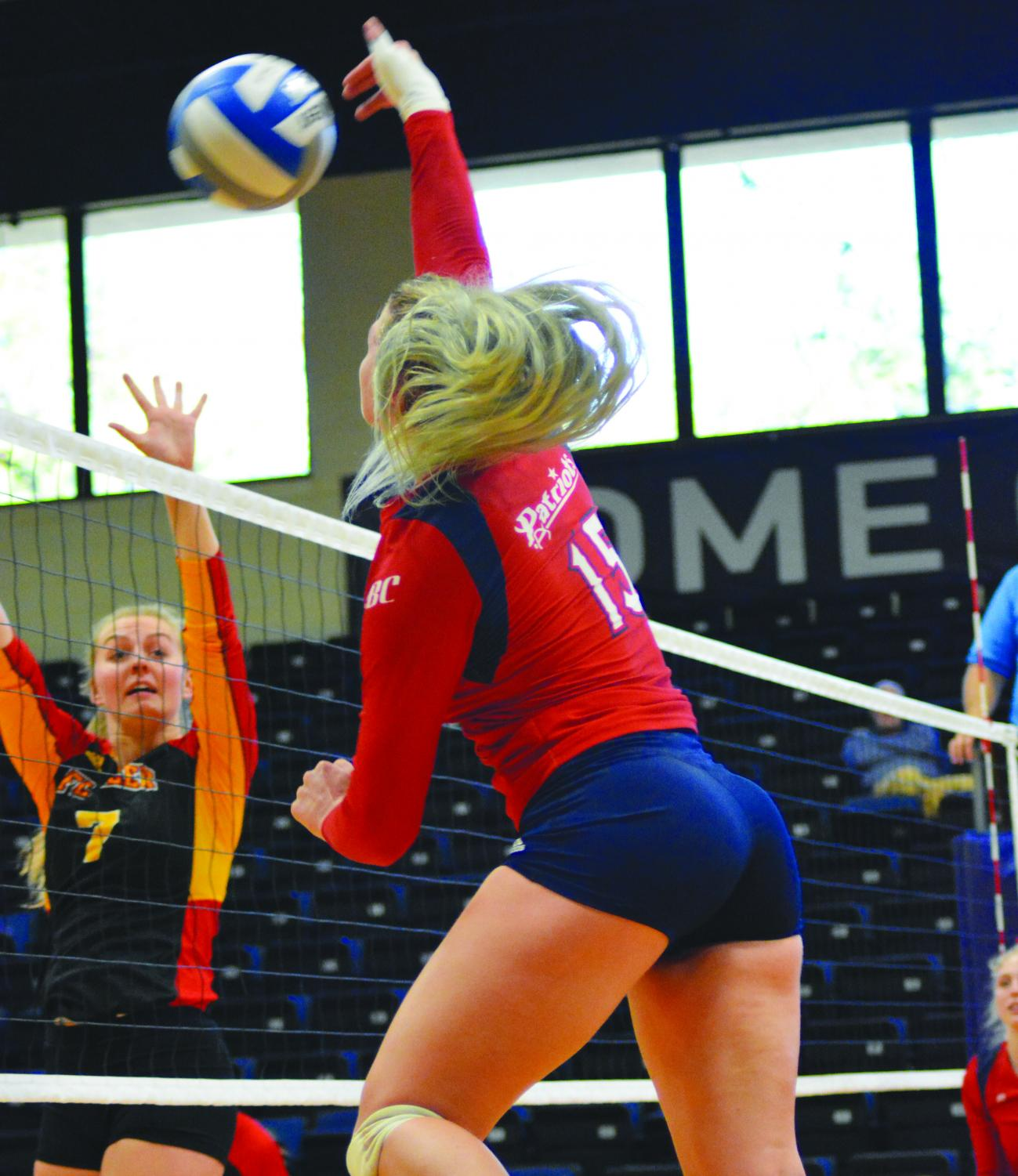 Shelbi Meek spikes the ball during the game against Flagler College. The Nov. 11 game is Meek's last game as a Patriot.