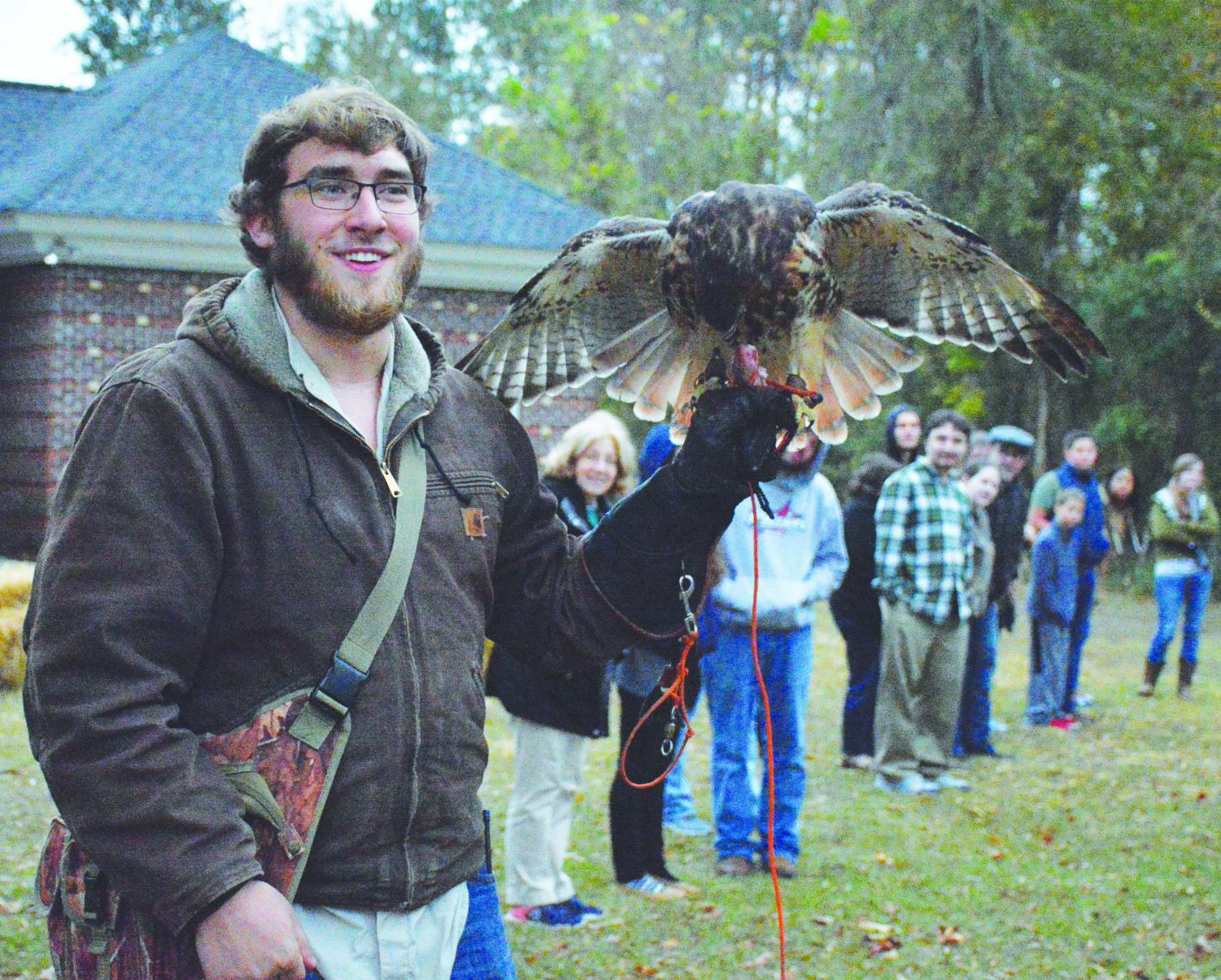 The Pre-Vet Club hosts an exhibit with FMU student Tyler Wright. Wright works in raptor conservation in his free time.