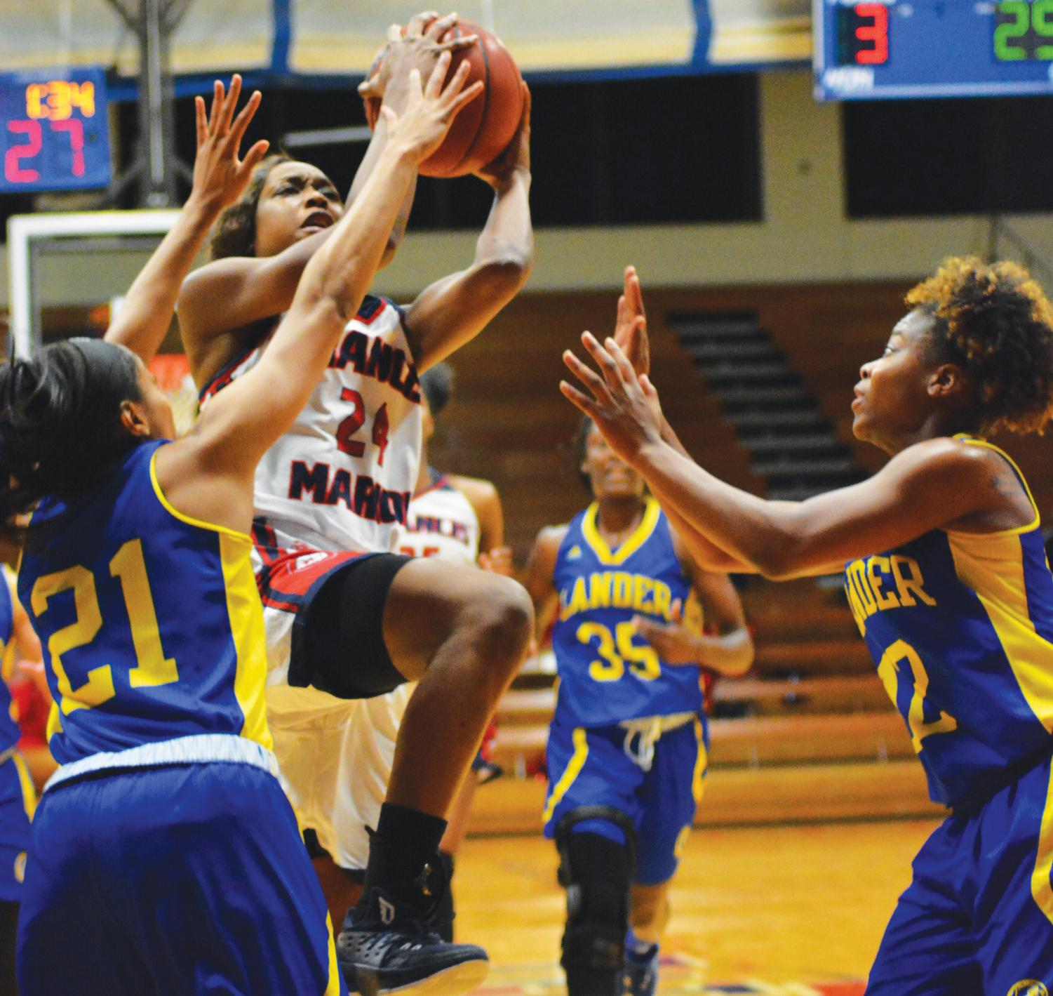 Junior Shaunice Fulmore (24)  lays up the ball against the Lander Bearcats. During this game, Fulmore scored 15 points.