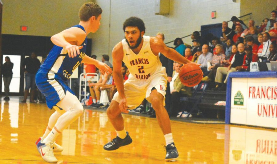 Detrek Browning dribbles the ball down the court during the Feb. 10 game against University of North Georgia.
