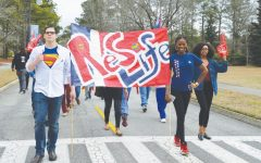 Club, organizations march in parade