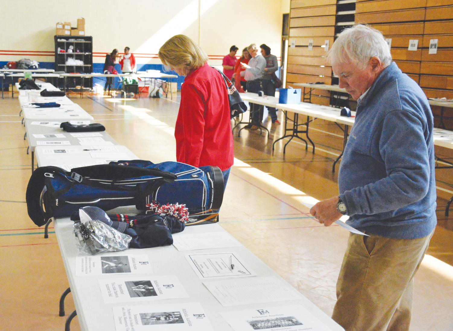 Members of the FMU community look through the items up for auction during the 2018 Homecoming Silent Auction. Proceeds from the auction go to the FMU Athletics Department.