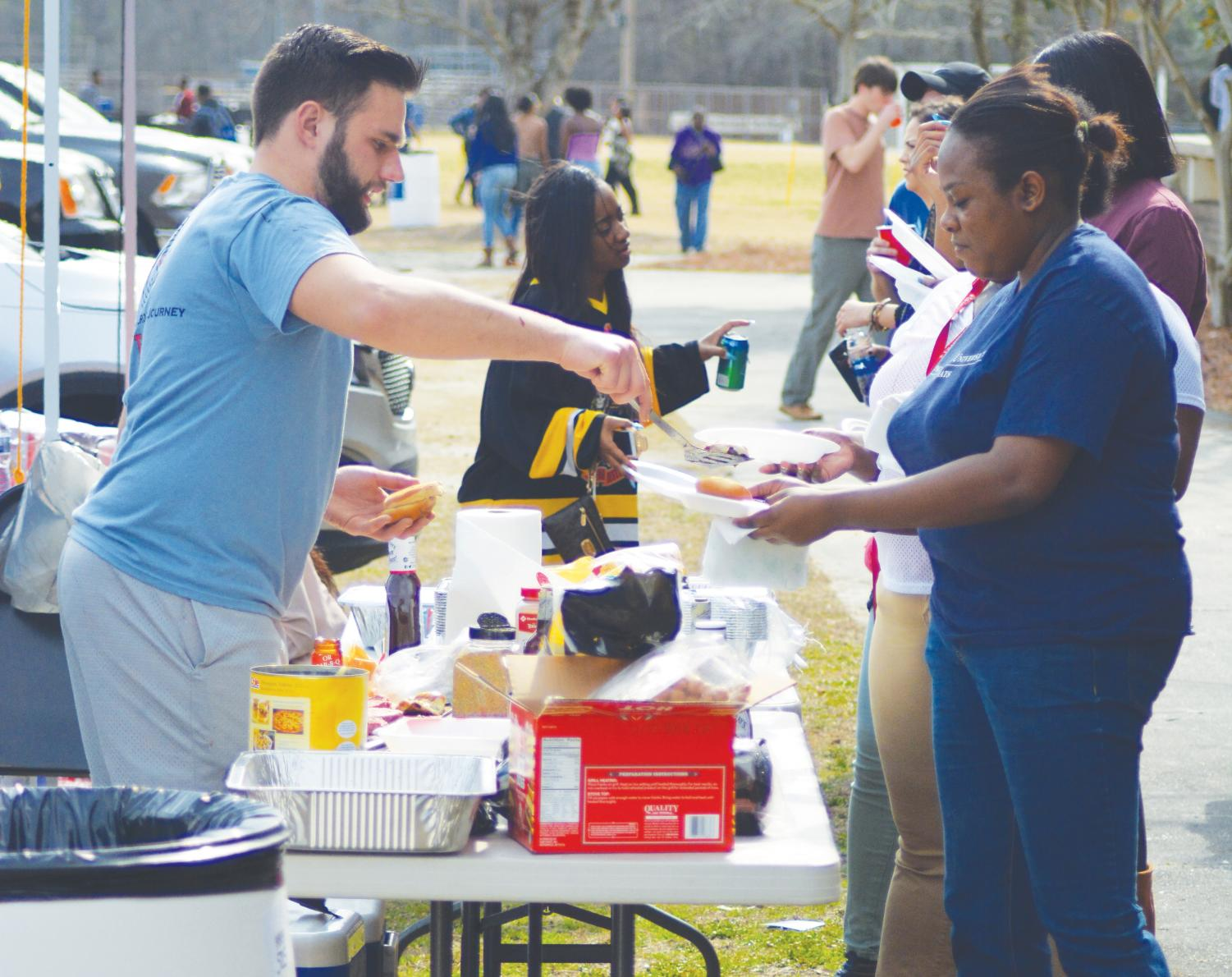 FMU faculty, students and alumni assemble tents and make food during the Homecoming tailgate. Tailgating took place from 11 a.m. throughout the basketball games.