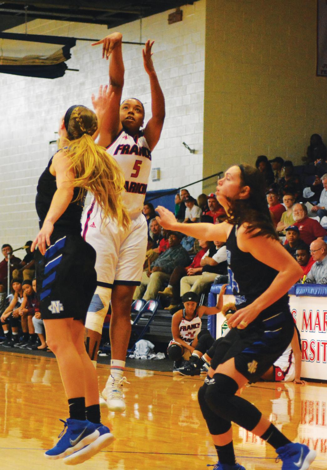 Keauna Williams, junior, shoots and scores against the lady Nighthawks from University of North Georgia.