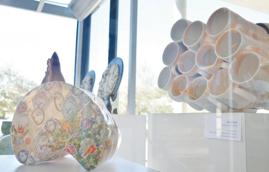 "Professor Doug Gray gathers the ceramics of different South Carolina professors in the ""SC Clay > High Ed"" exhibit."