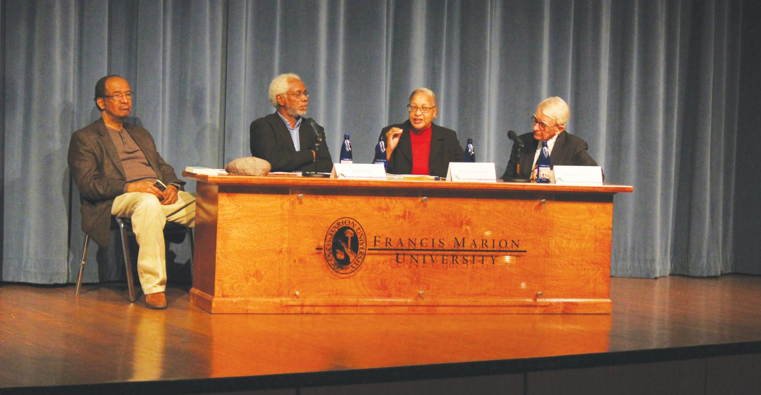 Panelists Herb Frazier, Valinda Littlefield and Joe Riley discuss Cleveland Sellar's discussion on race, culture and education on Feb. 28. Audience members asked panelists questions after the event.