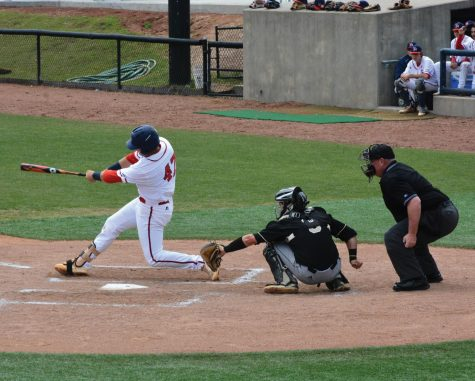 Trey Chapman, senior, scores a run against UNC Pembroke to help the Patriots win one game in Sunday's double header.